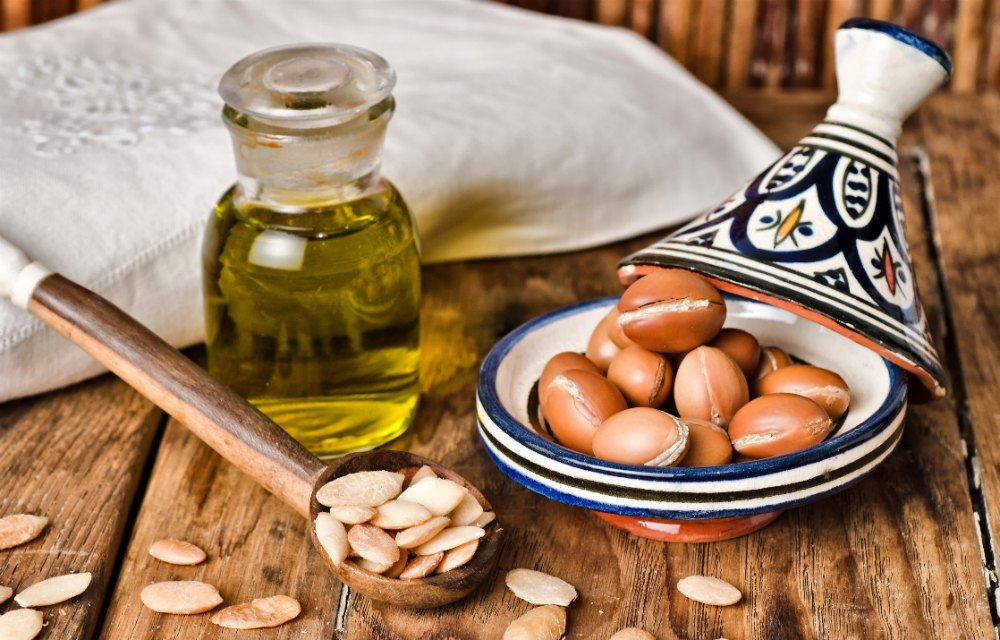 argan nuts in bowl with oil