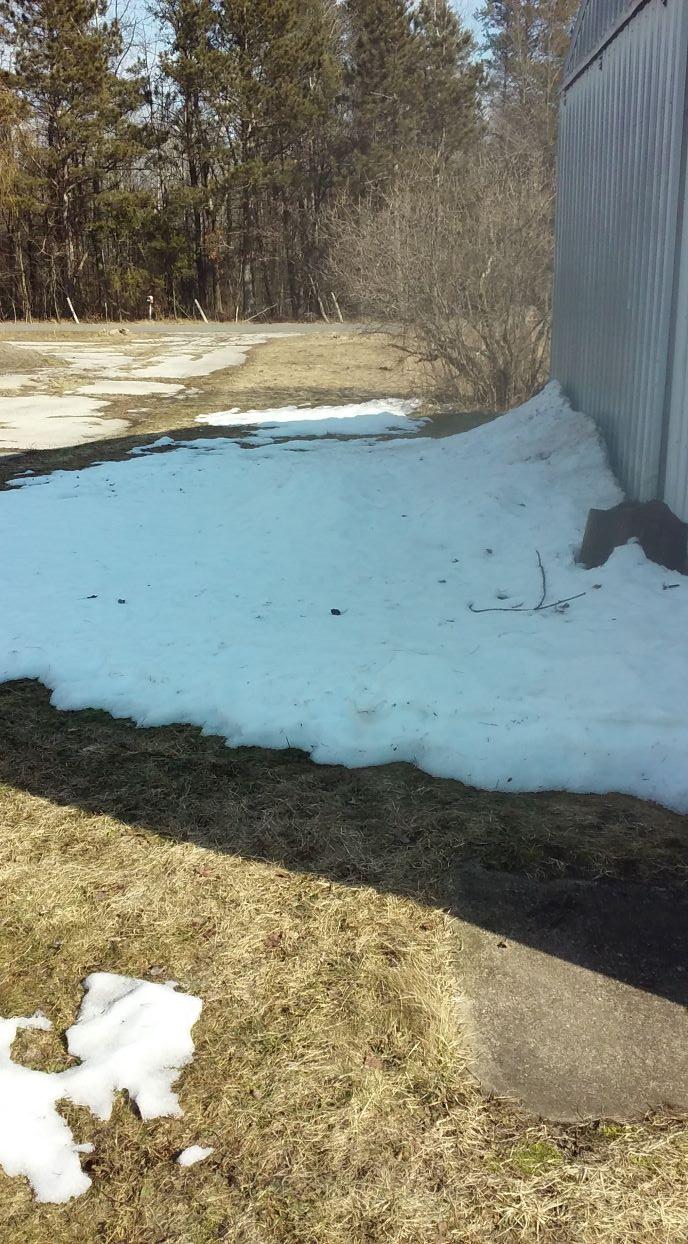 snow up against garage 030921